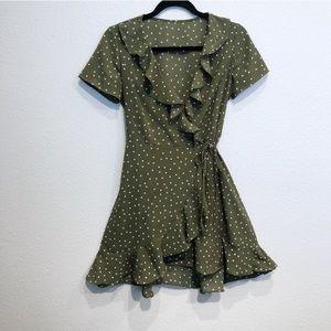 Green and white polka dot wrap around tie dress